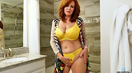 Red haired perfect lady Andi James is..