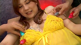 Buxom Asian brown-haired in yellow..