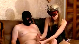 Lewd blondie in sable corset and mask..