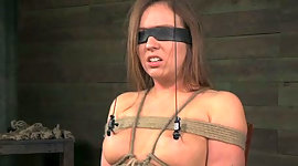Blind folded and tied up brown-haired..