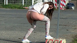 Dirty ebon haired chick pees near road..